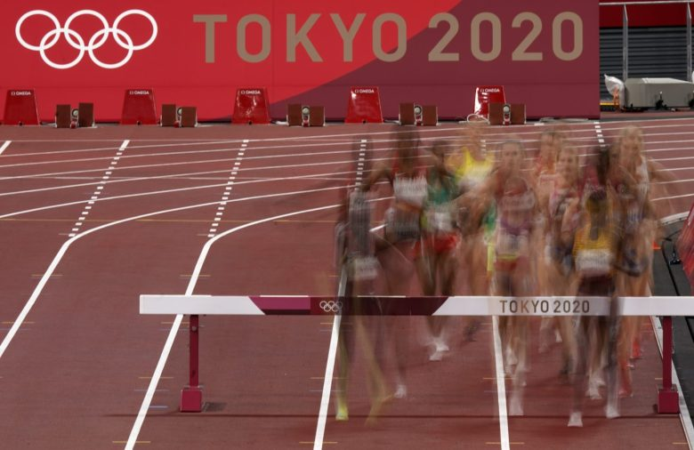 Competitors clear a barrier in the final of the women's 3,000-meter steeplechase at the 2020 Summer Olympics, Wednesday, Aug. 4, 2021, in Tokyo, Japan. (AP Photo/Charlie Riedel)