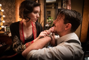Rooney Mara and Bradley Cooper in the film NIGHTMARE ALLEY. Photo by Kerry Hayes. © 2021 20th Century Studios All Rights Reserved