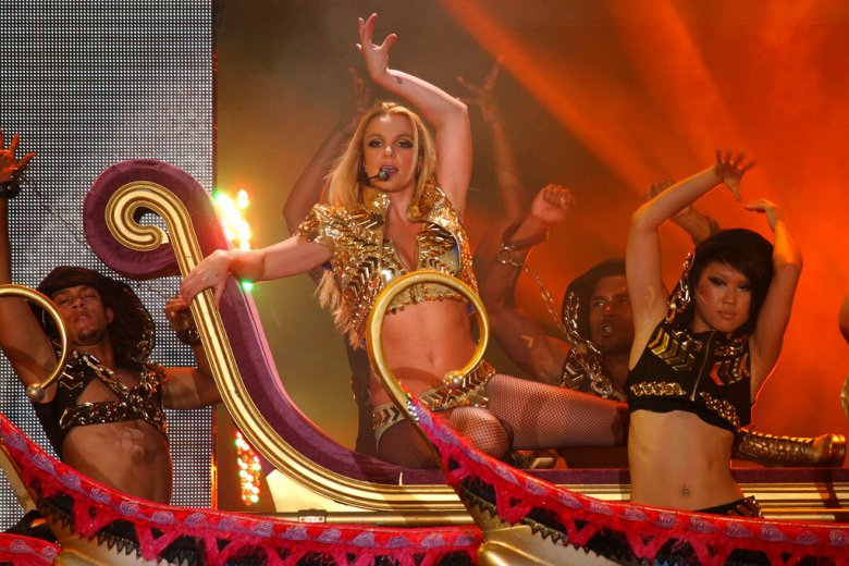 Britney Spears, center, performs on a stage during a concert in Moscow, Russia, Saturday, Sept. 24, 2011. Britney Spears performs in Moscow, St.Petersburg and Kiev as part of her European Femme Fatale Tour. (AP Photo)