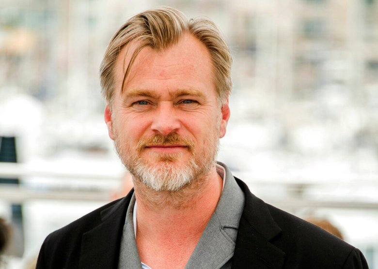 """FILE - In this May 12, 2018, file photo, director Christopher Nolan poses during a photo call at the 71st international film festival in Cannes, southern France. Warner Bros. says it will release Nolan's latest film, the sci-fi espionage spectacle """"Tenet,"""" in theaters on July 31, 2020. The release date has been closely watched because so many other releases during the film industry's blockbuster-filled summer season have been delayed due to the coronavirus pandemic. (Photo by Arthur Mola/Invision/AP, File)"""