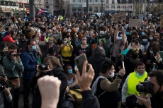 Protesters raise their phones and cameras at a demonstration in Marseille, southern France, Saturday, Nov. 21, 2020. Rights campaigners and journalists organizations staged street protests in Paris and other French cities on Saturday against a security bill that they say would be a violation of the freedom of information.The proposed measure would create a new criminal offense of publishing images of police officers with intent to cause them harm. (AP Photo/Daniel Cole)