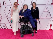 Nicole Newnham, from left, James Lebrecht, and Sara Bolder arrive at the Oscars on Sunday, April 25, 2021, at Union Station in Los Angeles. (AP Photo/Chris Pizzello, Pool)