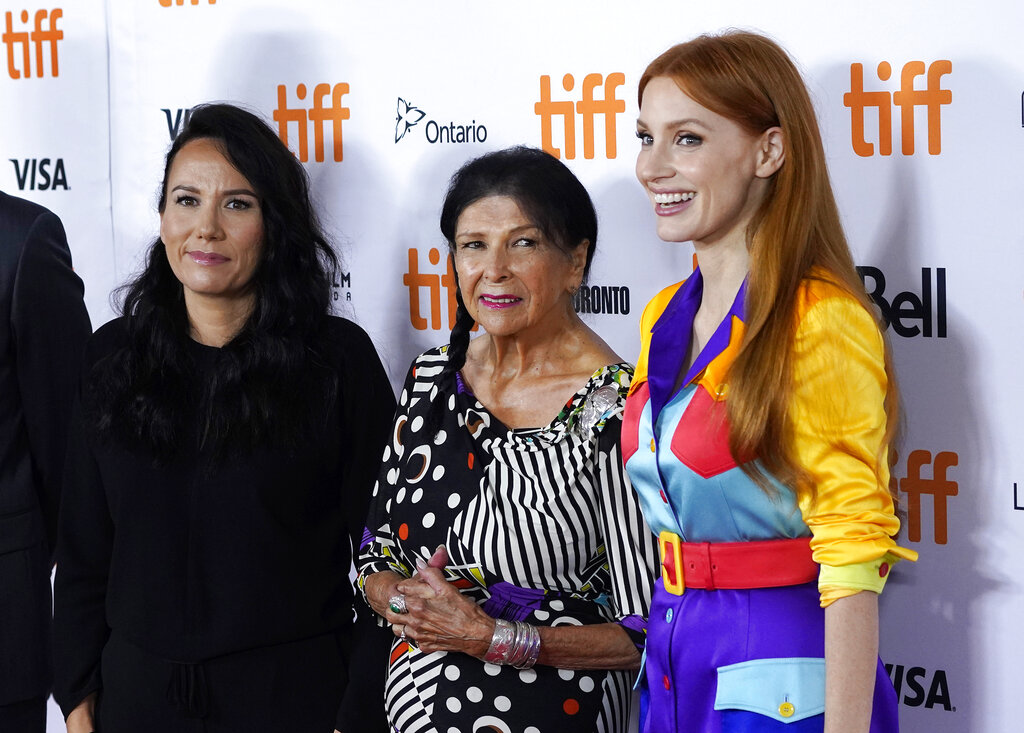 TIFF Tribute Actor Award recipient Jessica Chastain, right, poses with TIFF Emerging Talent Award recipient Danis Goulet, left, and Jeff Skoll Award in Impact Media recipient Alana Obomsawin during a photo op at the 2021 Toronto International Film Festival, Saturday, Sept. 11, 2021, in Toronto. (AP Photo/Chris Pizzello)