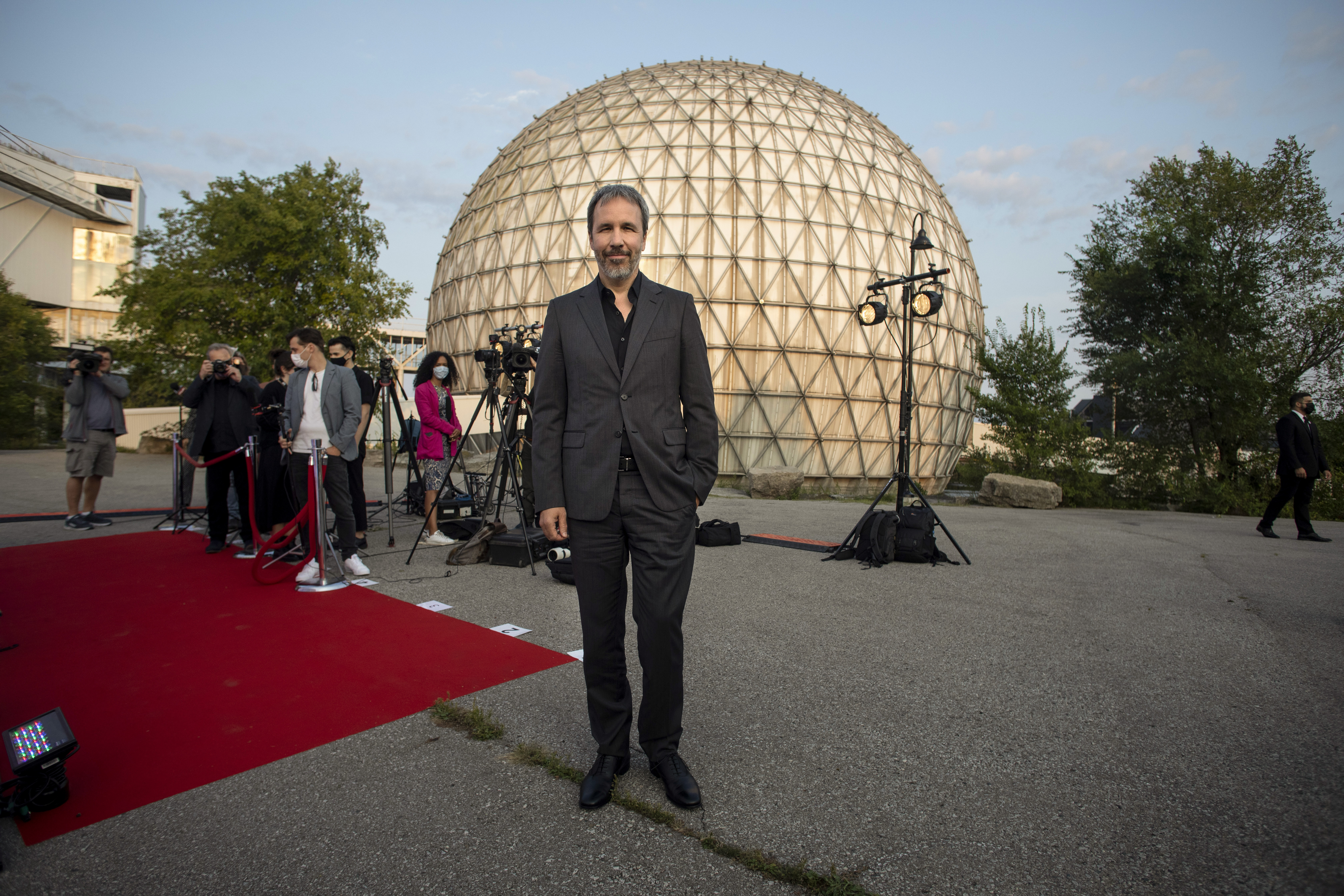 """Director Denis Villeneuve poses for a photo as he promotes the film """"Dune"""" in Toronto during the Toronto International Film Festival, on Saturday, September 11, 2021. (Chris Young/The Canadian Press via AP)"""