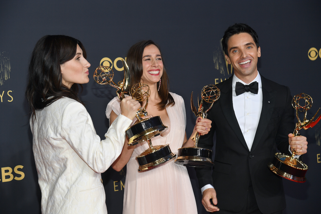 Jen Statsky, Lucia Aniello, and Paul W. Downs, winners of Outstanding Writing For A Comedy Series and Outstanding Directing For A Comedy Series for 'Hacks,' pose in the press room