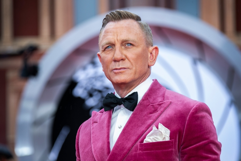 Daniel Craig poses for photographers upon arrival for the World premiere of the film 'No Time To Die', in London Tuesday, Sept. 28, 2021. (Photo by Joel C Ryan/Invision/AP)