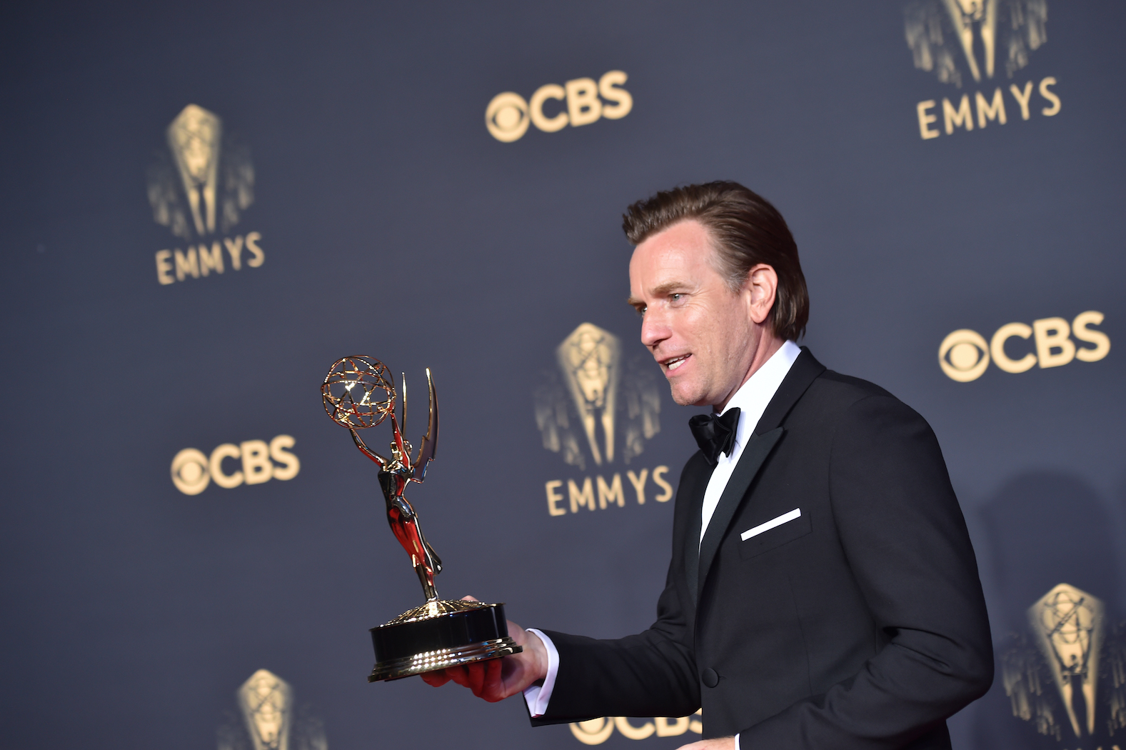 Ewan McGregor, winner of Outstanding Lead Actor in a Limited Series or Movie for 'Halston,' poses in the press room