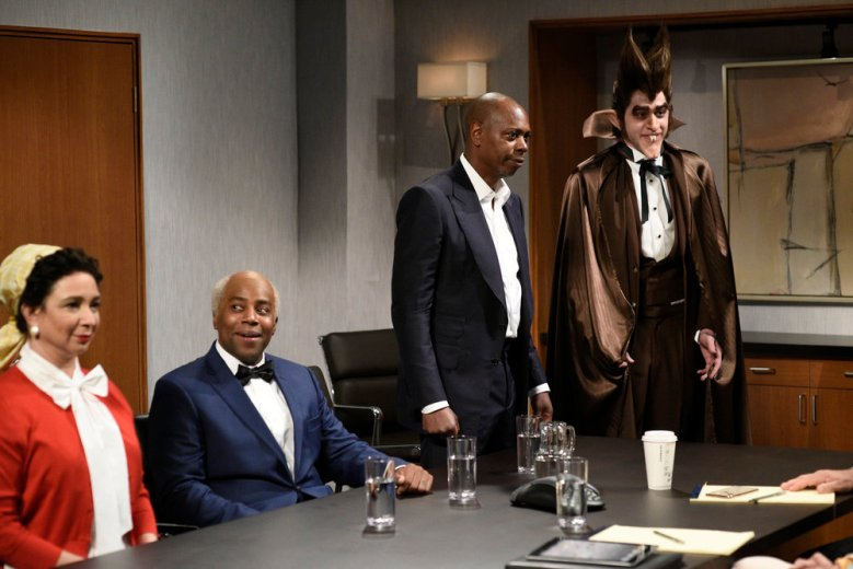 """SATURDAY NIGHT LIVE -- """"Dave Chappelle"""" Episode 1791 -- Pictured: (l-r) Maya Rudolph as Aunt Jemima, Kenan Thompson as Uncle Ben, host Dave Chappelle as the """"Allstate guy"""", and Pete Davidson as Count Chocula during the """"Uncle Ben"""" sketch on Saturday, November 7, 2020 -- (Photo by: Will Heath/NBC)"""