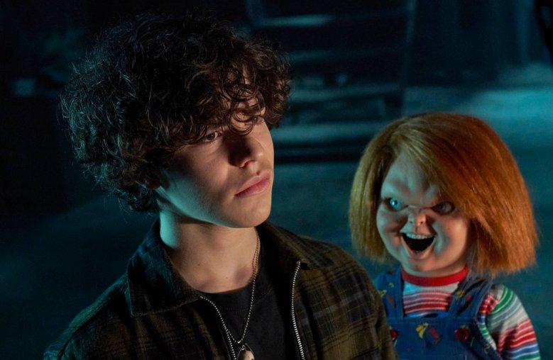 "CHUCKY -- ""Death by Misadventure"" Episode 101 -- Pictured: (l-r) Zackary Arthur as Jake Wheeler, Chucky -- (Photo by: Steve Wilkie/SYFY)"