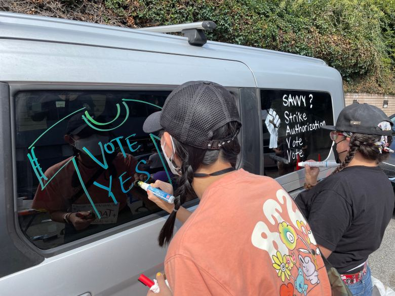 IATSE members paint messages of support of the upcoming strike authorization vote Sunday afternoon.