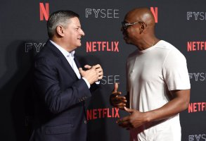 Ted Sarandos, left, and Dave Chappelle attend the 2018 Netflix FYSee Kick-Off Event at Raleigh Studios Hollywood on Sunday, May 6, 2018, in Los Angeles. (Photo by Richard Shotwell/Invision/AP)
