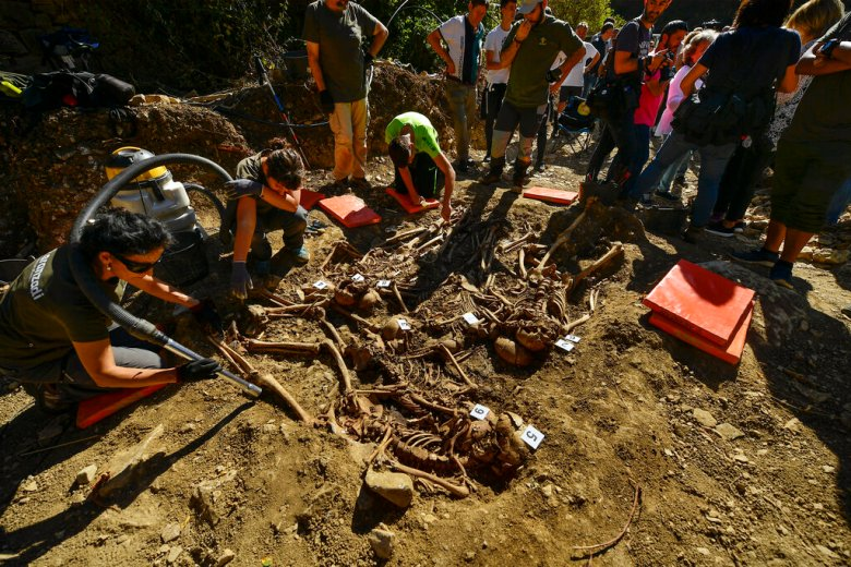 Archeologists inspect a grave in the small village of Ollacarizqueta, around 18 km (11, 18 miles) from Pamplona, northern Spain, Monday, Sept. 30, 2019. Archeologists have found a grave site in Ollacarizqueta containing what they believe to be the remains of sixteen republican prisoners killed during the Spanish Civil War. (AP Photo/Alvaro Barrientos)