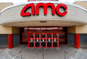 This May 8, 2020 photo shows an AMC Theatre is shown in Clinton Township, Mich.   AMC Theatres says it will have 98% of its U.S. movie theaters open on Friday, March 19, 2021, with more expected to open by March 26. Shares of AMC Entertainment Holdings Inc. are up more than 4% before the market open on Thursday.   (AP Photo/Paul Sancya)
