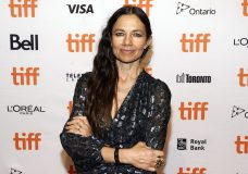 """Justine Bateman, writer/director of """"Violet,"""" poses before a screening of the film at the 2021 Toronto International Film Festival, Thursday, Sept. 9, 2021, in Toronto. (AP Photo/Chris Pizzello)"""