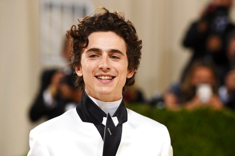 """Timothée Chalamet attends The Metropolitan Museum of Art's Costume Institute benefit gala celebrating the opening of the """"In America: A Lexicon of Fashion"""" exhibition on Monday, Sept. 13, 2021, in New York. (Photo by Evan Agostini/Invision/AP)"""