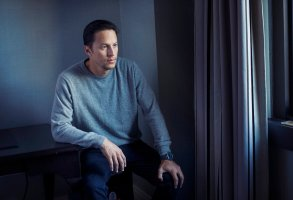 """In this Monday, Sept. 14, 2015 photo, director, Cary Fukunaga, poses for a portrait in promotion of his upcoming film """"Beasts of No Nation"""" at the 2015 Toronto International Film Festival in Toronto. The film, in which a young West African boy (Abraham Attah, an unprofessional 15-year-old actor from Ghana) is orphaned by war and enlisted into a rebel army led by Idris Elba's Commandant, was acquired by Netflix to be its first original film. (Photo by Victoria Will/Invision/AP)"""