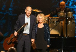 Carole King, right, and James Taylor perform on stage at the MusiCares 2014 Person of the Year Tribute on Friday, January 24, 2014 in Los Angeles. (Photo by Paul A. Hebert/Invision/AP)