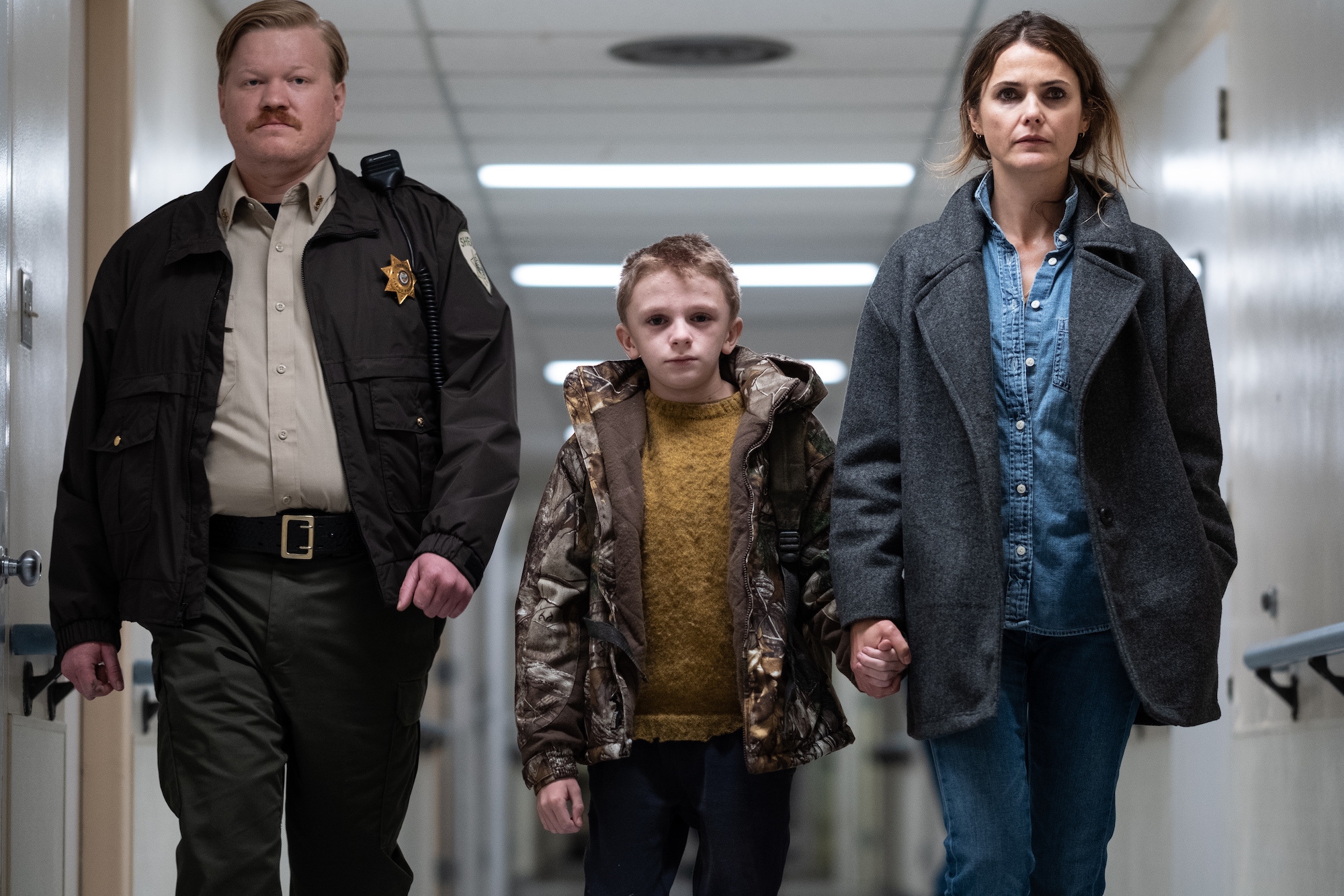 (From L-R): Jesse Plemons, Jeremy T. Thomas and Keri Russell in the film ANTLERS. Photo by Kimberley French. © 2021 20th Century Studios All Rights Reserved