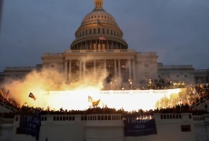Four Hours at the Capitol Documentary HBO January 6 -- An explosion caused by a police munition is seen while supporters of U.S. President Donald Trump gather in front of the U.S. Capitol Building in Washington, U.S., January 6, 2021. REUTERS/Leah Millis TPX IMAGES OF THE DAY - RC2M2L9E1RR3